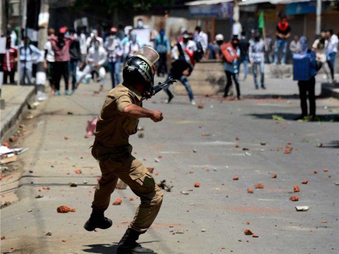 Civilian killed as forces  open fire on protesters