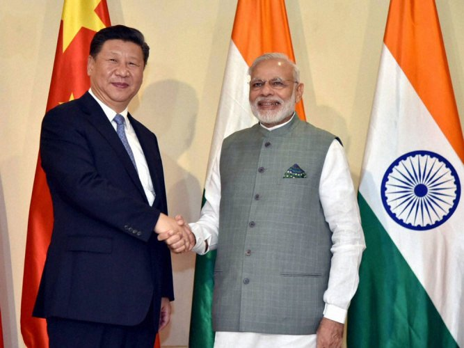 PM Modi meets Xi, discusses ways to improve China-India ties