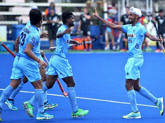 India hockey team players wear black arm bands