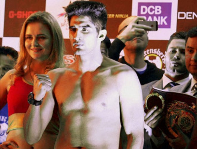 After backing out, Maimaitiali challenges Vijender again