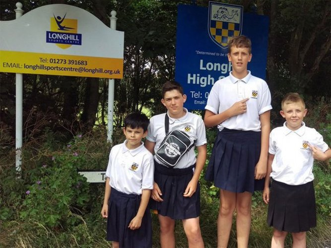 Boys turn up in skirts to protest UK school's 'shorts ban'