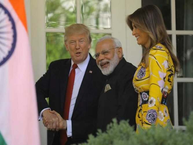 PM Modi gifts hand-woven shawls, Lincoln stamp to Trumps