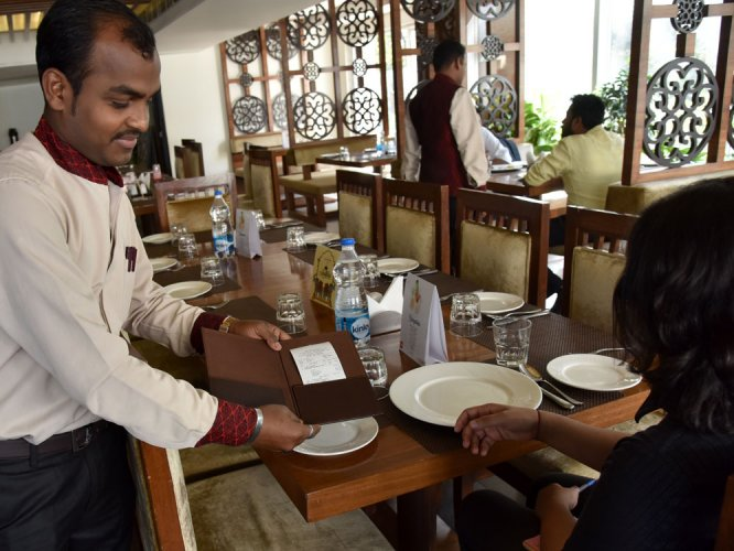 Gripped by jitters, city eateries down shutters early