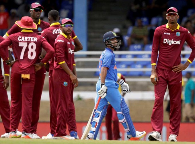 Slow batting sinks India, West Indies stay alive