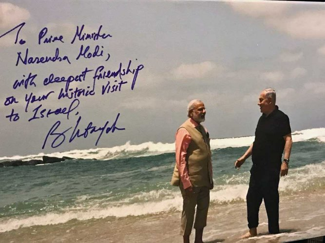 Netanyahu gifts signed picture to Modi
