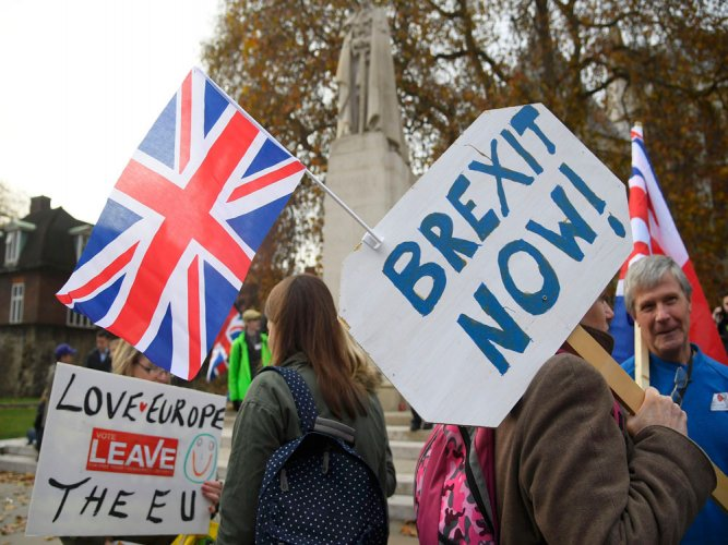 Brexit begins as UK publishes bill to repeal EU law