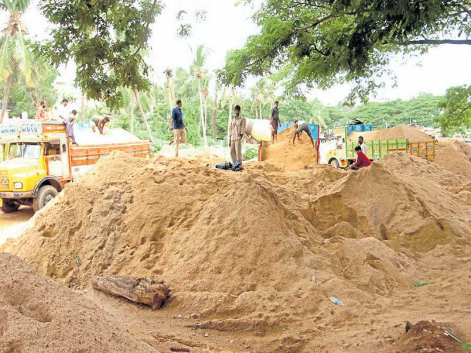 Drowning for sand: miners risk all for building boom