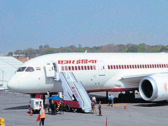 AI plane flies with landing gear out; 2 pilots taken off duty