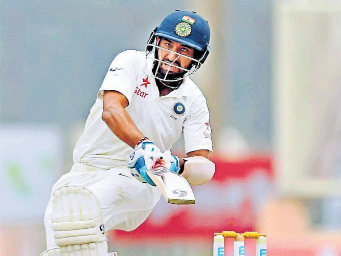 Pujara notches another 'fifty'