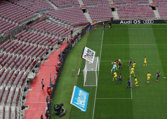Barcelona win behind closed doors