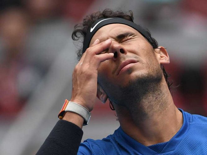 Gritty Nadal tames Isner