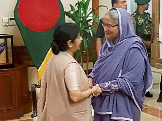 Return of 'displaced persons' can restore normalcy: Sushma in Dhaka