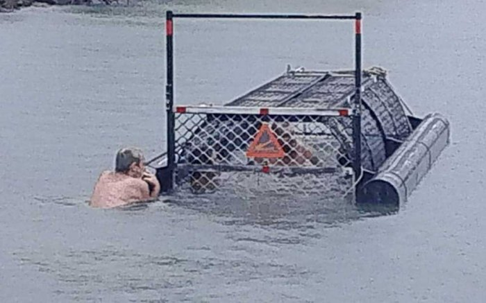 'Idiots of the century' swim in baited croc trap