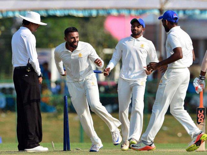 Karnataka prevail in tense finish