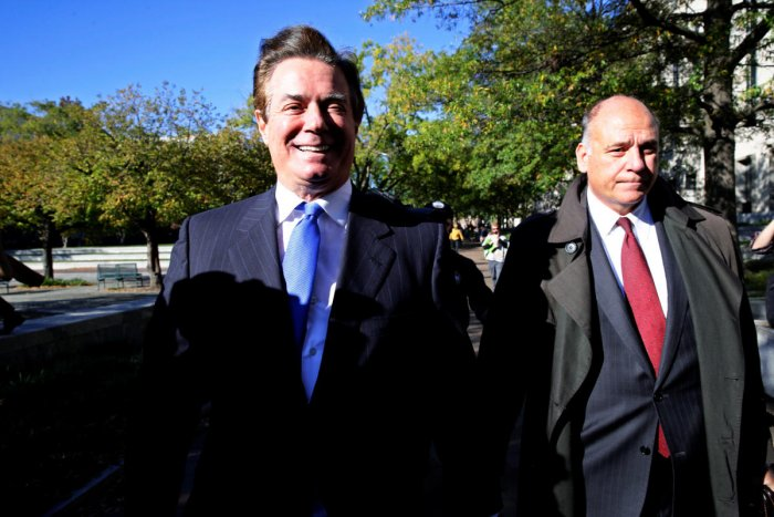Ex-Trump aides charged as Russia probe accelerates