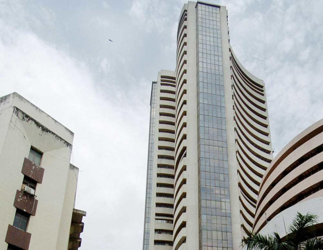 Sensex slips from record level, down 97 points