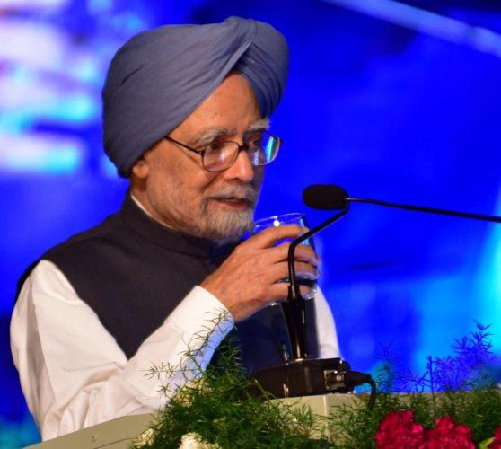 Manmohan Singh hits out at PM Modi on his home turf