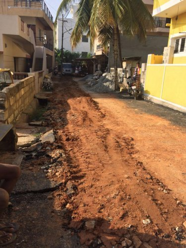 Newly laid road dug up to lay pipelines