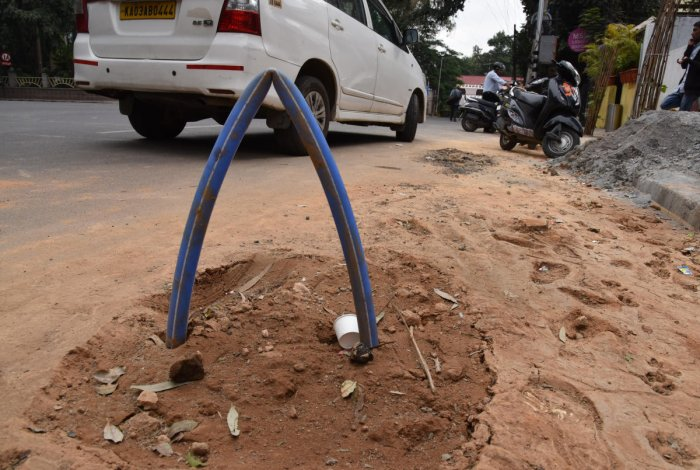 Digging by OFC firms leaves Lavelle Road in a mess