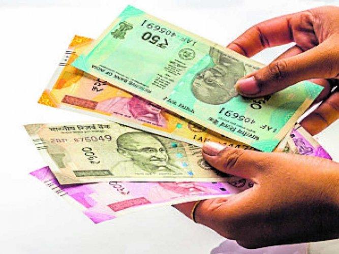 Rupee breaks free, runs up 69 paise on Moody's India upgrade
