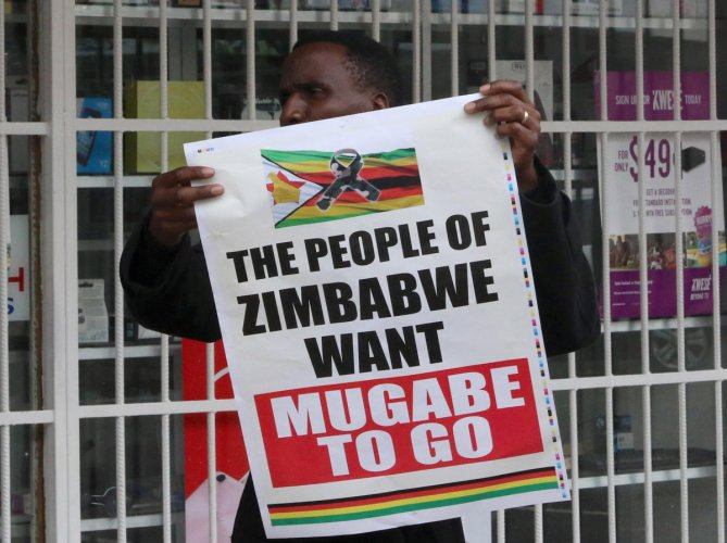 Zimbabweans march as Mugabe's future in the balance