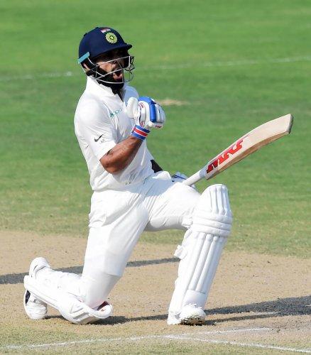 Lanka hang on to force draw