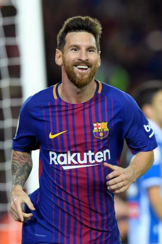 Messi extends Barca contract until 2021