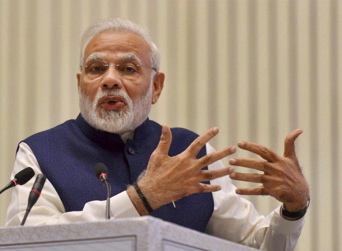 Modi bats for cooperation after CJI, law minister spar over
