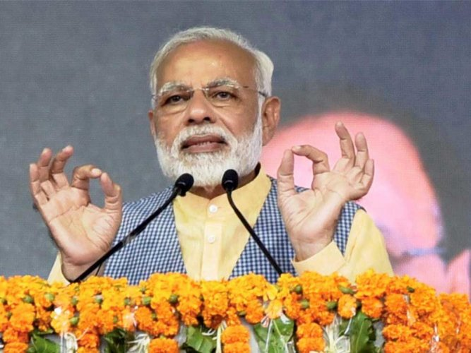 Guj poll is contest between trust on development and dynastic politics: Modi