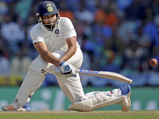 Rohit pleased with ton on return