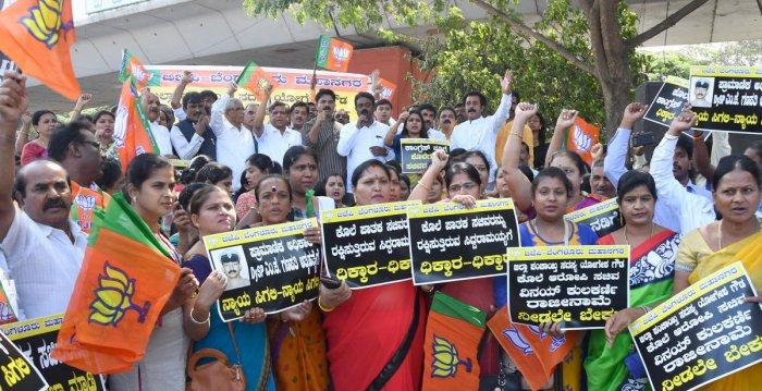 BJP leaders stage protest, demand resignation of George, Kulkarni