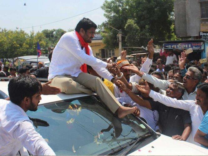 Rupani, Hardik clash with massive rallies