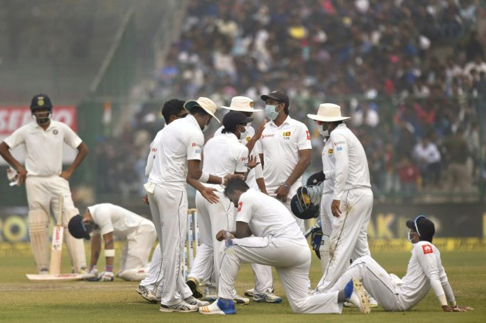 Oxygen cylinders arranged as SL players vomit