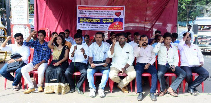 Strengthen government hospitals, demand protesters
