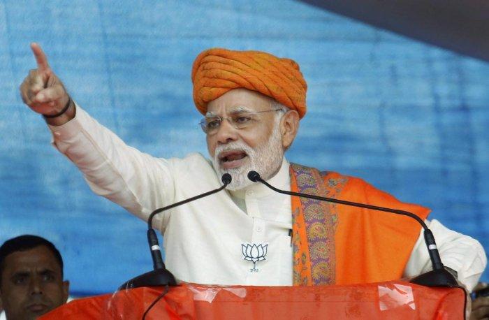 Modi lacerates Sibal over Ayodhya case deferment plea
