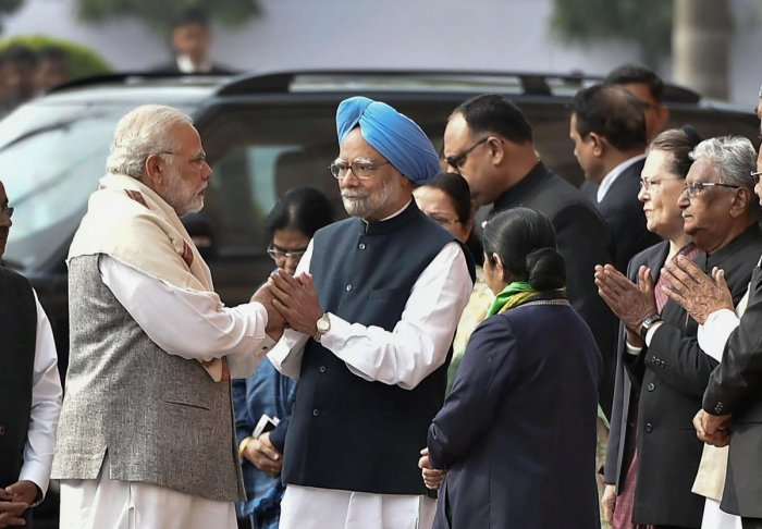 PM, Manmohan come face-to-face days after bitter war of words