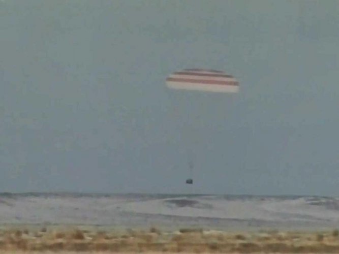 Two astronauts, cosmonaut return from five-month ISS mission