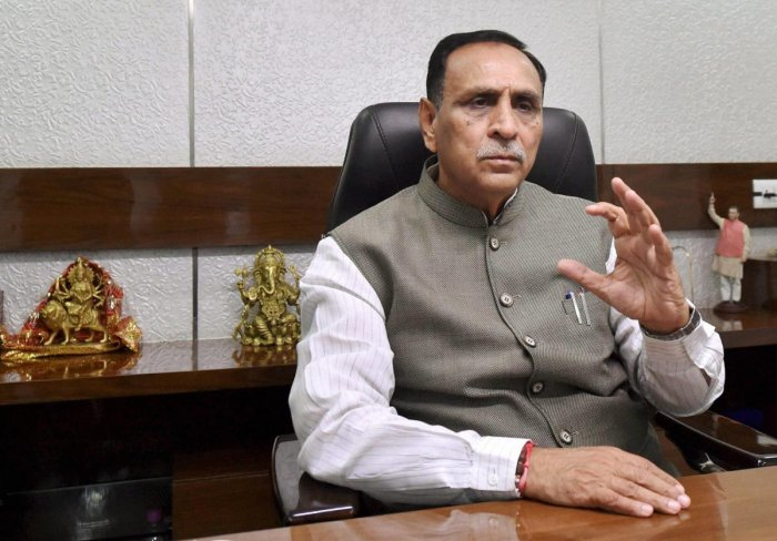 Chief Minister Rupani trails behind Cong in Rajkot West