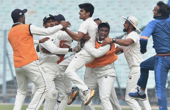 Karnataka bow out fighting