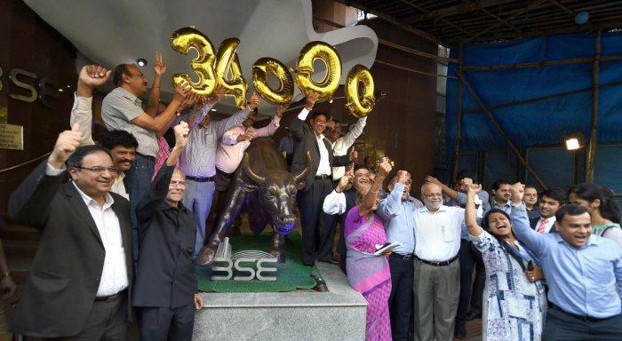 Sensex gets off record level, oil risks linger