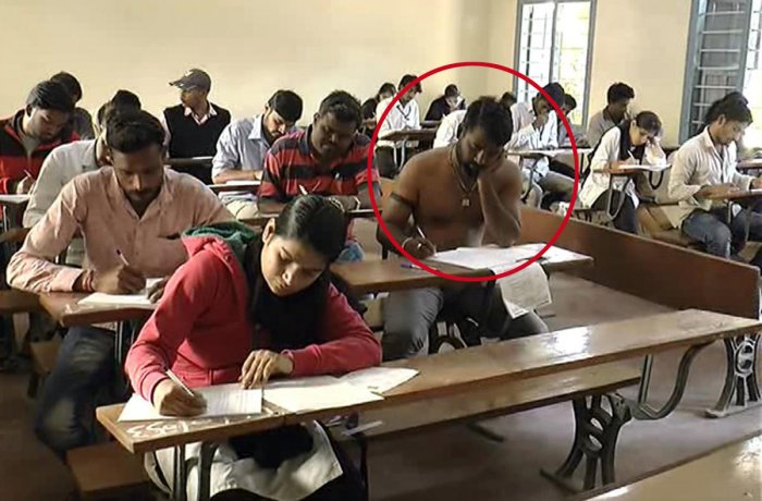 Three law students write exams bare-chested as mark of protest