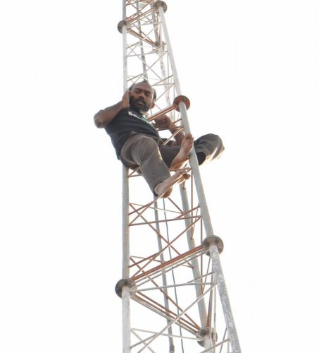 Land dispute: man climbs CCTV camera tower in protest