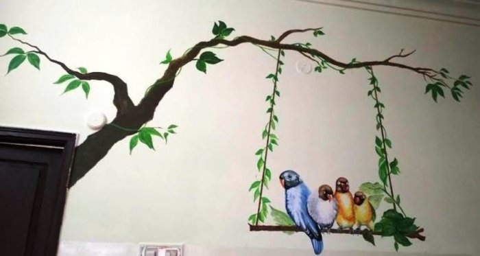 Artists decorate grey walls with chirpy hues