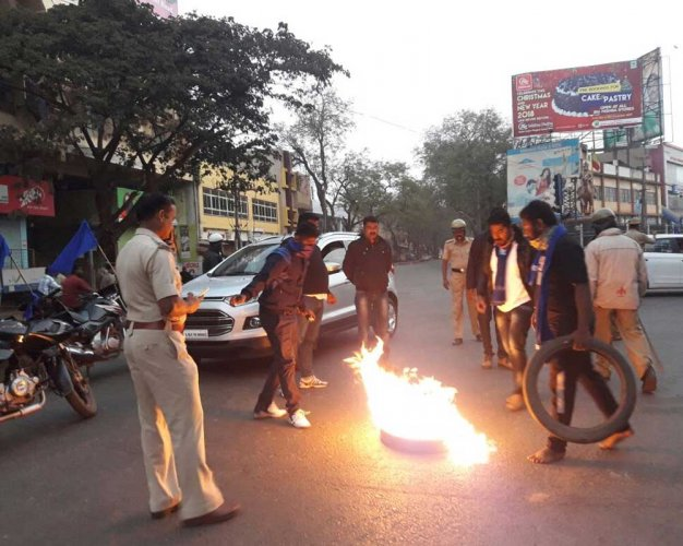 Dalits protest atrocities in Hubballi, burn tyres
