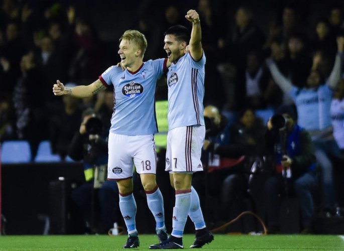 Real's title defence dented by Celta