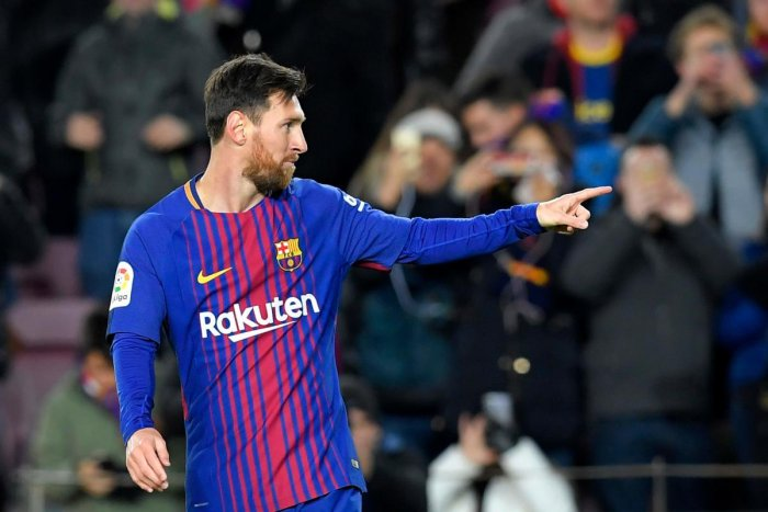 Messi powers Barcelona into quarters