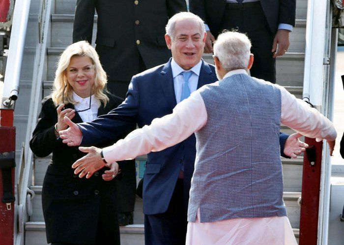 Cong tweets 'humorous' images of Modi hugging world leaders