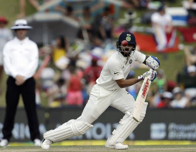 Kohli leads India's fight