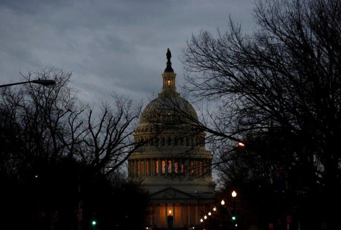 US govt workers awake to shutdown, Senate vote looms