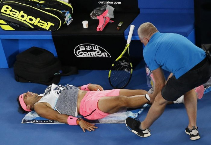 Nadal retires hurt, Cilic in semifinals